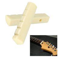 guitarras electricas diestras al por mayor-43mm Guitarra Bridge Nut Saddle Dentada Guitarra Tuerca Plástica Eléctrica Accesorios de Guitarra Acústica 6 Cuerdas Guitarra Nut