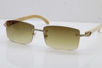 ingrosso vetri ottici grande design-2019 Nuovi occhiali da sole più grandi liberi di trasporto Occhiali da sole senza montatura ottici caldi Designer Bianco Corno di bufalo più piccolo Pietre grandi Occhiali da sole