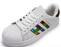 cordones brillantes al por mayor-moda de alta calidad del deporte de las mujeres zapatos casuales superestrella zapato con cordones de las mujeres pisos de los hombres brillantes zapatos de láser