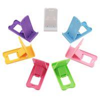 soporte para teléfono plegable al por mayor-Yuntohe Soporte universal para teléfono móvil Soporte plegable para teléfono para iPhone Soporte para tableta de escritorio Soporte para teléfono celular para Xiaomi