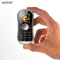 радио-сим-карты оптовых-DOITOP Hifi музыка MP3-плеер Fidget Gyro Spinner мобильный телефон поддержка двойной SIM-карты GPRS BT FM-радио ручной Spinner мобильный телефон MP3