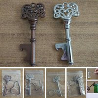 Wholesale open metal ring - New Vintage Keychain Openers For Beer Bottle Metal Coca Can Opening Tool With Ring And Chain Line Kitchen Bar Tool WX9-508