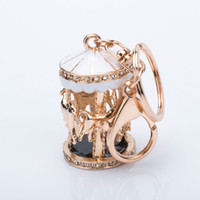брелок для ключей оптовых-Novelty Charm Glitter Crystal Carousel Car Keychain Trojans Keyring Women Handbag Bag Key Chain Ring Holder Jewelry