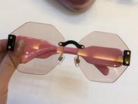 taraflı güneş gözlüğü toptan satış-Lüks 08 S Güneş Kadınlar Tasarımcı Popüler Moda Sekiz Yan Şekil Çerçevesiz Güneş Gözlüğü Moda Kadın Stil Pembe Kılıf Ile Gelmek 08N