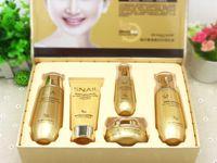 branqueamento conjunto de rosto venda por atacado-Livre DHL Bioaqua Caracol de Ouro Rosto Conjunto de Cuidados Da Pele Hidratante Clareamento Creme Facial Toner Leite Essência Limpador