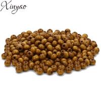 boulier perles achat en gros de-XINYAO 500pc 6X4mm Perle En Bois Naturel Perle Abacus Perles Lâche Spacer Perles Avec 2mm Trou pour DIY Bracelet Bijoux Trouver F7486