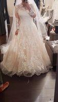 lange ärmel bodenlänge tüll großhandel-Long Sleeves Bodenlangen Juwel Spitze Applique Vintage Brautkleider A LLine nach Maß Tulle New Wedding Gowns