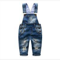 calças de brim de meninos em geral venda por atacado-2-7 T Marca Crianças Calça Jeans Meninos Meninas Macacão Jeans Criança Suspender Calça Jeans Calça Casual Moda Infantil Jeans Buraco No Varejo