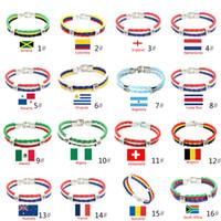 mundo da jóia venda por atacado-Pulseiras Jóias World Cup Nacional PU Bandeiras Lembrança Copa Do Mundo Para As Mulheres Homens Fãs de Moda Corda Trançada Encantos Pulseira De Couro PU