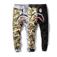 diseños de corredores al por mayor-Pantalones de chándal de boca de tiburón de los hombres Pantalones de compresión de color de la marca Diseño de la marca Pantalones de deporte de Hip Hop Jogger Hombres Cintura elástica Trous