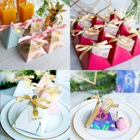 Wholesale christmas giveaways - 50 Creative Triangular Pyramid Wedding Favors Candy Boxes Bomboniera Giveaways Boxes Party Gift Box With Ribbons and Tags