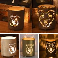 linternas de velas al por mayor-Titular de vela de Navidad Reno Tealight Hollow Metal Candlestick Lantern Para XMas Party Decorativo 5 Estilo HH7-1830