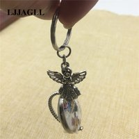 Wholesale ring base 25mm resale online - Tibetan Key Chain Christian Angel Buddhism Ganesha Charm Fit mm Cameo Rotatable Photo Base Key Rings Diy Jewelry AYSQ220