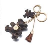 leder schlüsselanhänger für autos großhandel-Autoschlüsselring-Beutelcharme Neue Art! Schlüsselketten-Zusätze Quasten-Schlüsselring PU-Leder-Bären-Muster-Auto Keychain Schmucksache-Beutel-Charme