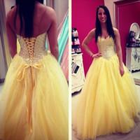 7e5f18d9e Venta al por mayor de Vestidos De Quinceañera Amarillos Rhinestones ...