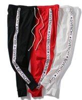 pantalon de jogging européen achat en gros de-automne et hiver pantalon de garde populaire européen et américain chaîne de ceinture impression hommes et femmes pantalons sport occasionnel couple sportif