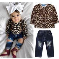 leopard print top girl großhandel-INS Baby Mädchen Outfits Kinder Leopard Druck Top + Löcher Denim Hosen 2 teile / satz Mode Frühjahr Herbst Kinder Kleidung Sets C5399