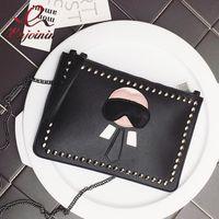 kişiselleştirilmiş omuz çantaları toptan satış-Yeni Karikatür tasarım kişiselleştirilmiş moda Lafayette perçinler zarf çanta debriyaj çanta çanta rahat omuz çantası siyah gümüş