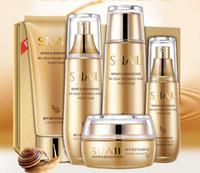 ingrosso sbiancante set faccia-Bioaqua Gold Snail Face Set per la cura della pelle Idratante Sbiancante Crema per il viso Toner Essence Latte Detergente Set per il viso in Corea