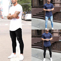 zipper das calças dos homens venda por atacado-Calças de Brim Casuais Skinny Calças Dos Homens Denim Lápis Calças Estiramento Do Vintage 2018 Outono Verão Buraco Rasgado Masculino Com Zíper Jeans Plus Size