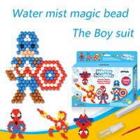 juguetes educativos al por mayor-Agua caliente Aqua cuentas juguetes pegajoso perler beads pegboard set fusible cuentas rompecabezas de Agua grano mágico beadbond juguetes educativos para niños