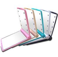 espelho de mão conduzido venda por atacado-Novo Espelho de Maquiagem com 8 Luzes LED Lâmpadas Cosméticos Portátil Dobrável Compacto Espelho de Mão de Bolso Compõem Sob Luzes SN1026