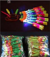 lighted slingshot helicopter NZ - LED lights toys Amazing LED Flying Arrow Helicopter umbrella Slingshot for kids birthday Christmas gift party supplies 300pcs lot Free DHL