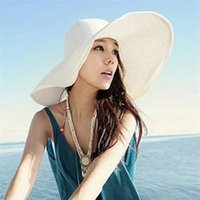 Wholesale ladies bow hats - Sunscreen Sunshade Hats Lady Summer Beach Flodable Wide Brim Straw Bow Panama Hat Seaside Holiday Hand Knit 10lx cc