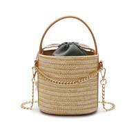 bolso de paja de playa con cordón al por mayor-2018 New Fashion Straw Bucket Drawstring Women Shoulder Bag 4Colors Ladies Cross body Chain Beach Bag Tamaño 15cmx10cmx15cm