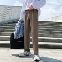 pantalones salvajes de los hombres al por mayor-2018 otoño nuevos pantalones casuales de los hombres de color sólido salvaje recta suelta pantalones de color caqui / negro tamaño S-XL franqueo gratis
