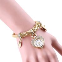 relógios com forma de coração de quartzo venda por atacado-Mulher moda vestido relógios oco de aço inoxidável cobra textura da pele banda pulseira de strass relógio de quartzo de ouro do presente em forma de coração dial