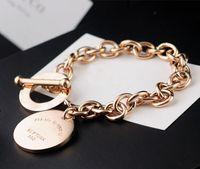 ot pulsera al por mayor-316L titanio acero chapado en oro corazón colgante pulsera para la joyería de la pulsera de la hebilla OT de las mujeres