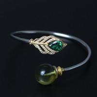 braceletes de pulseira de 14k venda por atacado-Designer de moda jóias de prata esterlina 925 pulseira de ouro 14 K charme Zircon pena de pavão Azul Bangle manguito ajustável mulheres presente artesanal