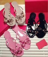 sandalias planas para niñas al por mayor-Moda de verano Chanclas Mujer remaches Sandalias de mujer Bow nudo Zapatillas planas Niñas tachonado Cool Beach Slides Jelly Shoes 35-41