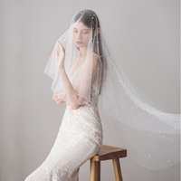 Wholesale fingertip veils resale online - 2018 Elegant Ivory One Layer Tulle Beading Pearls Bridal Veils Fingertip Length Luxury Wedding Veils With Comb CPA1423