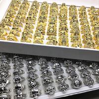 einzigartige schädelringe großhandel-Großhandel 100 stücke Mix Styles Silber / Gold Gothic Schädel Schmuck Ringe für Männer Frauen Party Geschenke Einzigartige Punk Rock Biker Ring Nagelneu