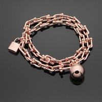 braceletes de bola de ouro 18k venda por atacado-Comércio por grosso de pulseira de titânio T hot bola de aço bloqueio U em forma de carta dupla pulseira com pulseira de ouro 18k Ms.