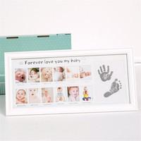 bebek fotoğrafları duvar toptan satış-Taoqueen Bebek Fotoğraf Çerçevesi Yenidoğan Fotoğraf Çerçevesi Duvar Resimleri için Handprint Ayakizi Mürekkep Pedi Çocuk Hediye Kadro Odası Dekor