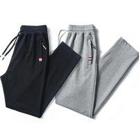 pantalones de chándal fino al por mayor-Pantalón de chándal para hombre de HanHent para hombre Pantalones deportivos largos de color sólido Pantalones finos de moda Pantalones de entrenamiento escolar