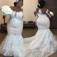 Wholesale amazing beaded wedding dresses online - Amazing African Mermaid Wedding Dresses Luxury Beaded Lace Appliques Long Sleeve Bridal Gowns Sexy Sheer Scoop Plus Size Wedding Gowns