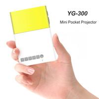 lcd ekran sistemi toptan satış-Mini Taşınabilir LCD Projektör 600LM Cep Proyector Ev Medya LED Multi-medya AV HDMI USB Soğutma Sistemi için Tiyatro Büyük Ekran Oyun YG-300