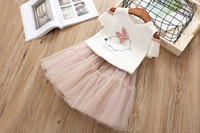 Wholesale girl holiday outfits - Kids Bow Rabbit Print Off Shoulder Tees with Tulle Ruffles Dress 2 pcs Set Sweet Girls Summer Holiday Outfit