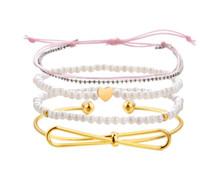 bogen armbänder ring großhandel-Bohemia Perlen Bogen Herz Armband Seil Armbänder für Frau Baumwolle handgemachte Charme Nachahmung Perlen Armband Armreifen Set Schmuck