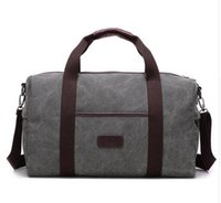 Wholesale leather travel bag for sale - 55CM large capacity men women travel bags famous classical designer hot sale high quality men shoulder duffel bags carry on luggage