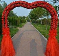 metall stieg blumen großhandel-Romantisches und edles Hochzeitsseidenblumentürmetallrahmen rosafarbene Blumenbogentür für die großartige Hochzeitsszenenvorbereitungsdekoration.