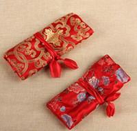 rollos de joyas de seda al por mayor-Chino tradicional estilo de moda de seda mujeres joyería rollo de almacenamiento de viaje bolsa de embalaje bolsas de satén patrón mixto