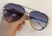 paquete original de gafas de sol al por mayor-Gafas de sol de lujo 0297 para mujeres Diseñador encantador con la mujer de la perla Gafas de sol ovaladas de moda Protección UV de calidad superior con el paquete original