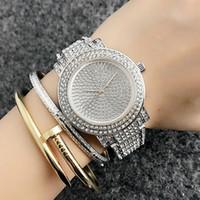 güzel saat kadın toptan satış-Moda Marka güzel kadın Kız kristal tarzı Paslanmaz çelik band Kuvars bilek İzle M39