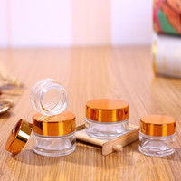 pots cosmétiques couvercles en or achat en gros de-Clear Glass Cosmetic Cream Bottle Round Jars Bottle with Inner PP Liners for Hand Face Cream Bottle 5g to 100g Gold Silver Lids