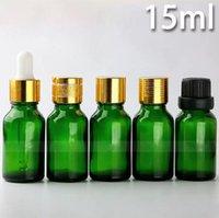 15 ml de garrafas de óleo essencial verde venda por atacado-Venda quente 15 ml de vidro verde garrafas de óleo essencial vazio e cigarro garrafas de líquidos 15 ml com tampa de rosca de ouro preto em ações
